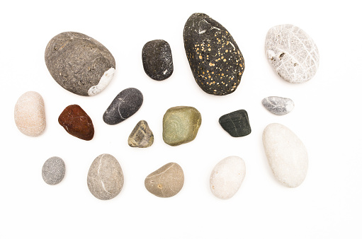 Set of Pebbles sea stones isolated on white background. Top view.