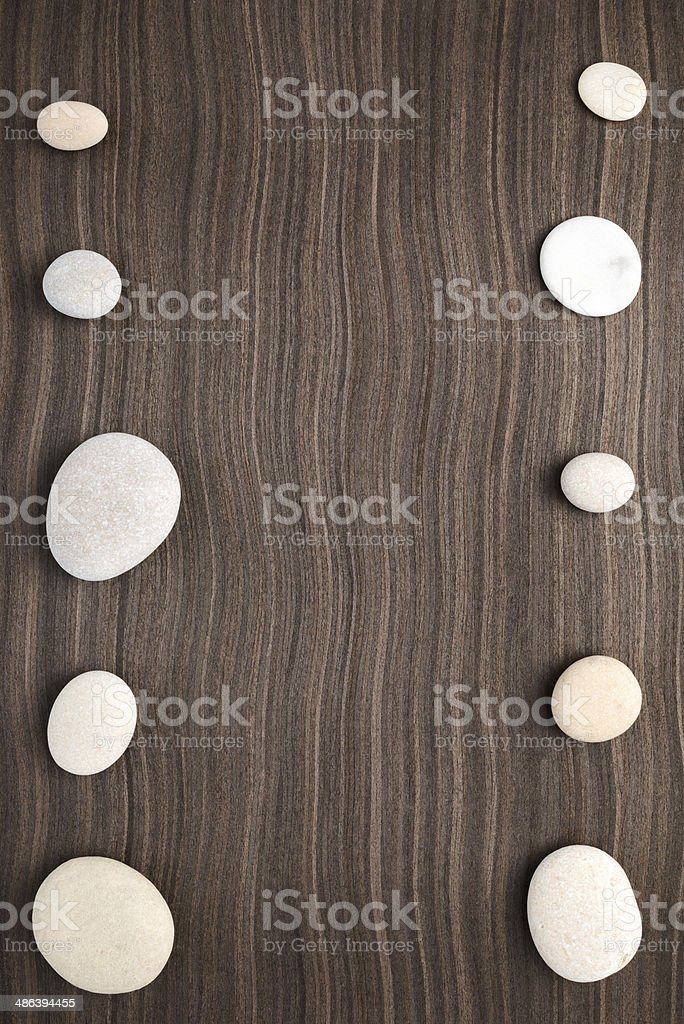 pebbles on ebony wood texture stock photo