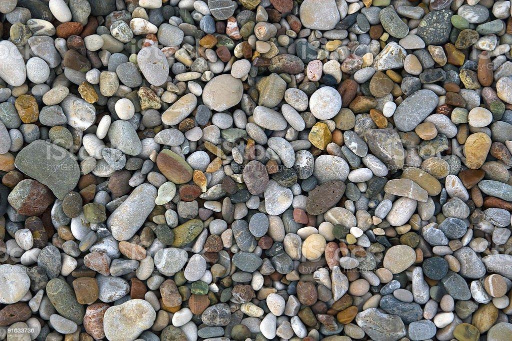 Pebbles on sea shore stock photo