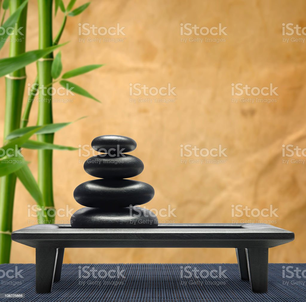 Pebbles on Tray with Bamboo royalty-free stock photo