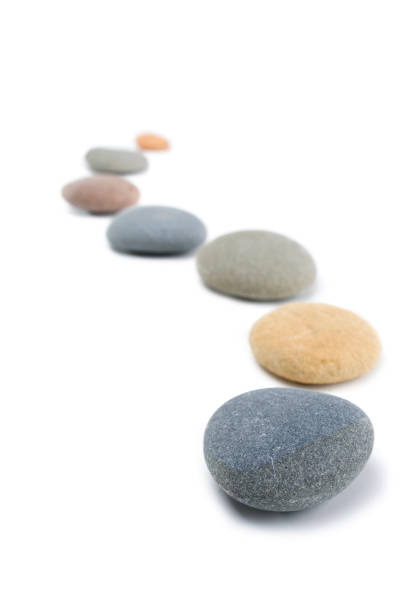 Pebbles on White, in a Snaking Line stock photo