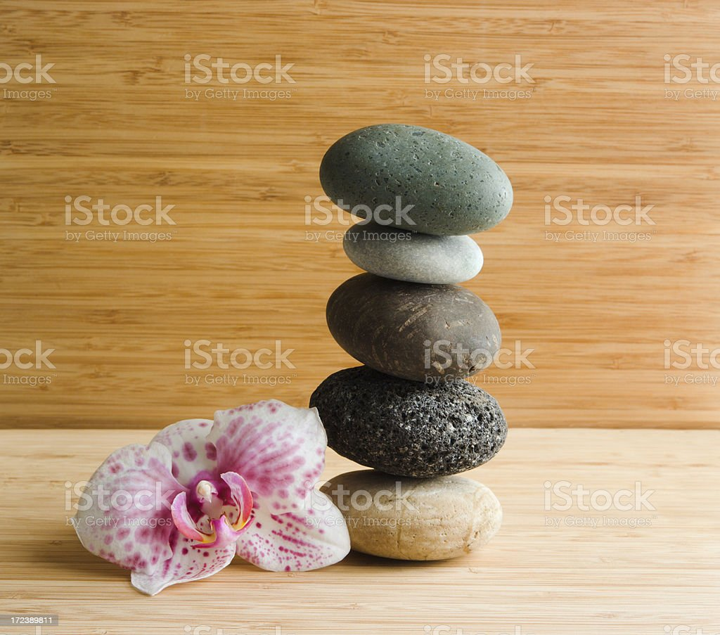 Pebbles & Orchid on Bamboo royalty-free stock photo