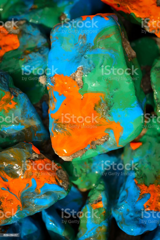 pebbles painted in different colors stock photo