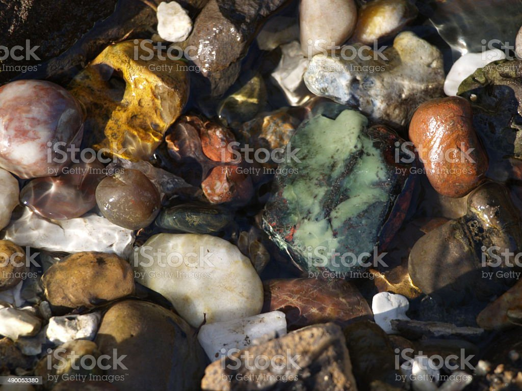 Pebbles, rocks and stones in a stream of water stock photo
