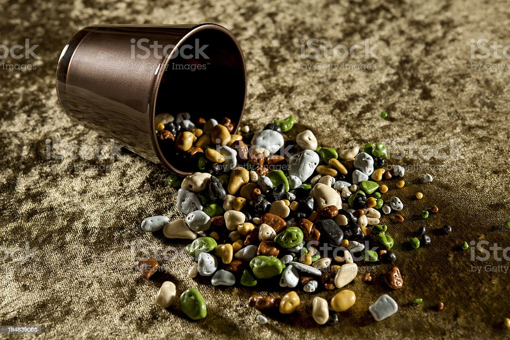 pebbles spilled out of brown glass stock photo