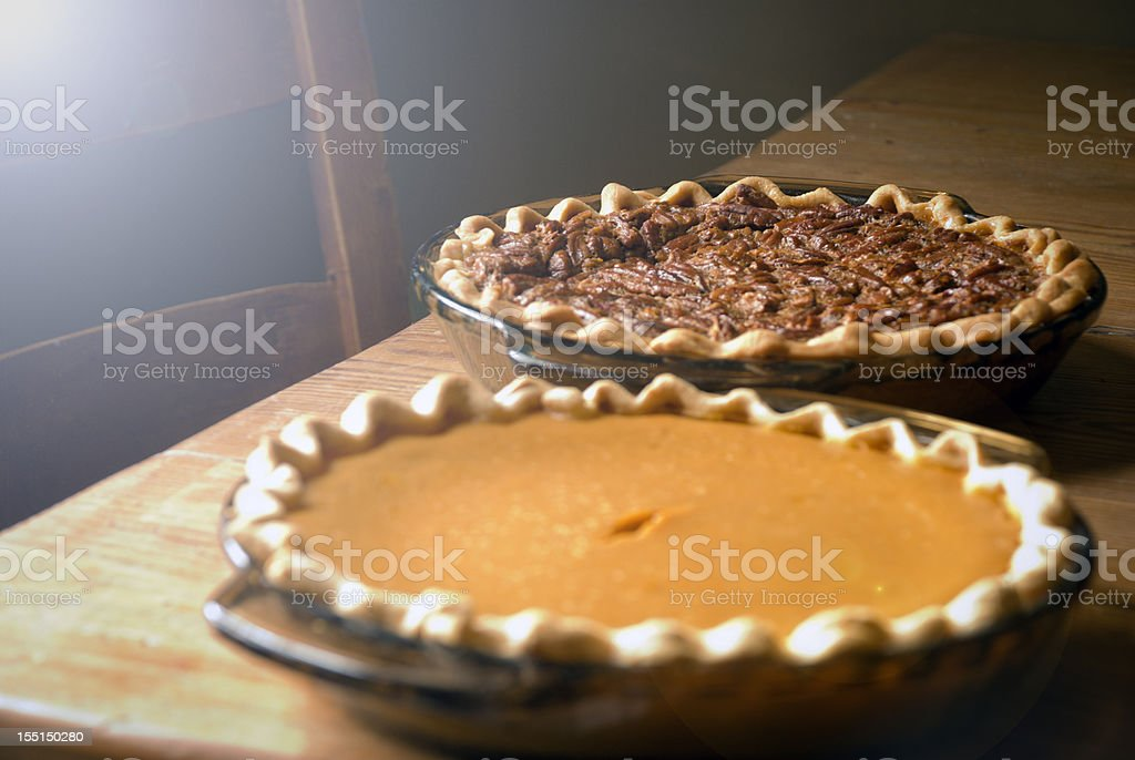 Pecan and Pumpkin Pies in Vintage Setting royalty-free stock photo