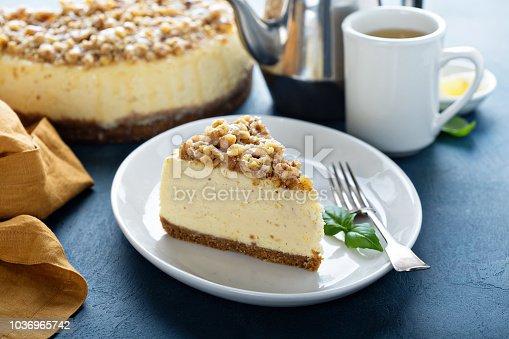 Slice of pecan caramel cheesecake, fall dessert recipe