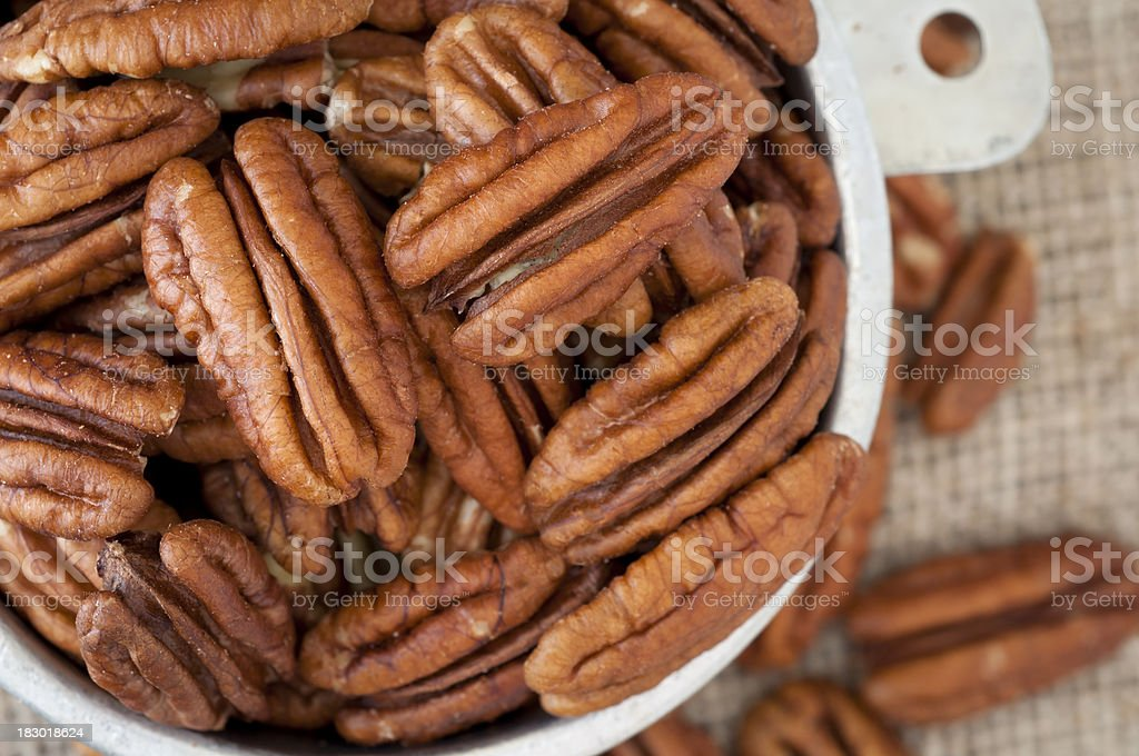 Pecan Halves in a Measuring Cup from Above stock photo