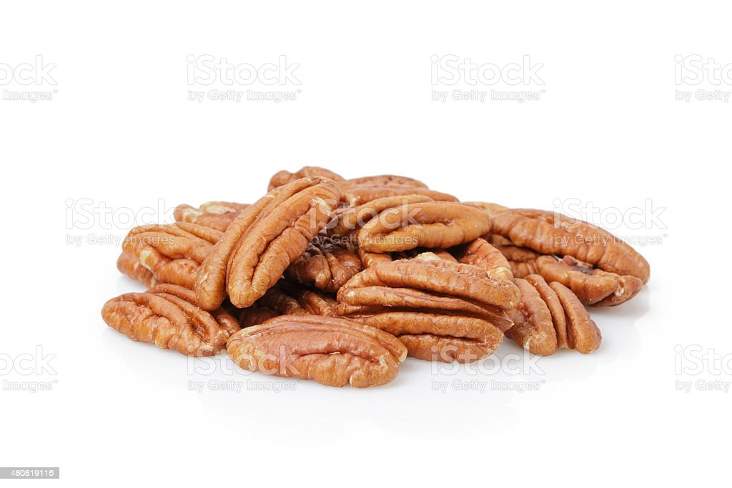 Pecan halves isolated on a white stock photo