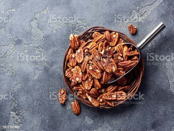 Pecan nuts and scoop on gray table picture id1017157862?b=1&k=6&m=1017157862&s=612x612&h=tsj1zltwfk pyqmkfvrcgkbd8uypzbzqf2 cne63ckk=