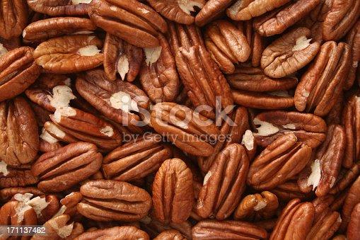 Top view of halved pecan nuts