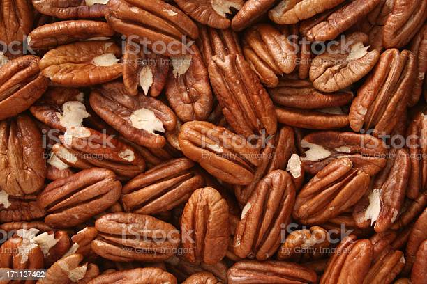 Pecan nuts background picture id171137462?b=1&k=6&m=171137462&s=612x612&h=ttfpbq7ocgtvanhtqfdatbqpq04txbnhwhff1z2lj5e=