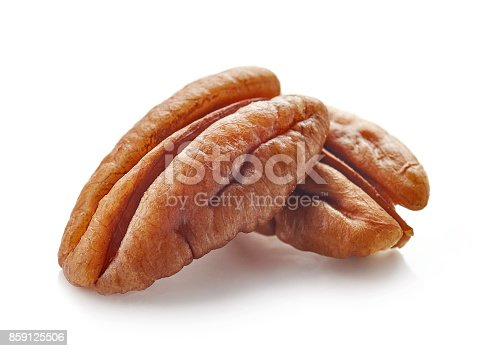 Pecan nuts macro isolated on white background, selective focus