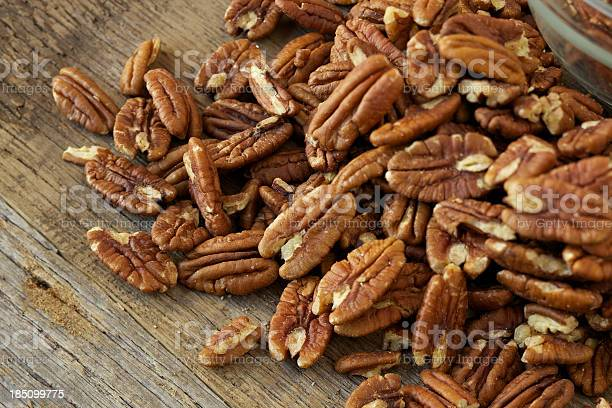 Pecan nuts on rustic wood table picture id185099775?b=1&k=6&m=185099775&s=612x612&h=mbu9qey5euo0wkfr04wqq6w9kosg32zg0el3u6tulzm=