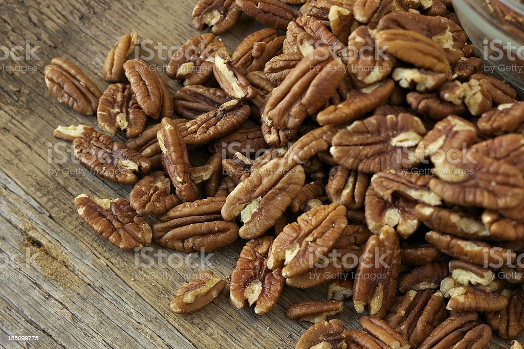 Pecan nuts on rustic wood table stock photo