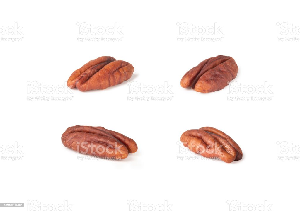 Pecan nuts topped with light salt isolated in pieces on white background, macro shot (clipping path included of each piece) stock photo