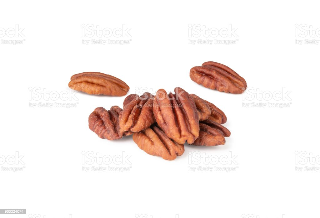 Pecan nuts topped with light salt isolated in pieces on white background (clipping path included of each piece) stock photo