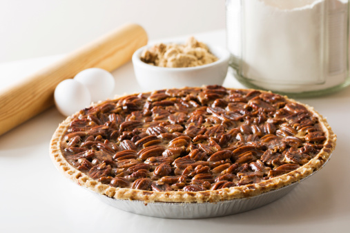 Pecan Pie Fresh Baked Holiday Dessert With Ingredients Rolling Pin Stock Photo - Download Image Now