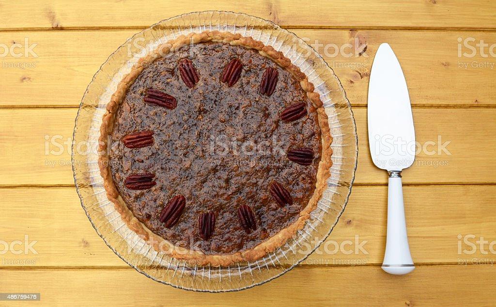 Pecan pie with pie server stock photo