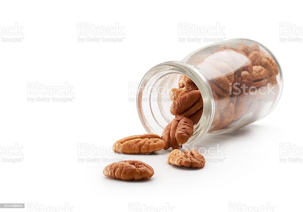 Pecans Pouring Out From Bottle stock photo