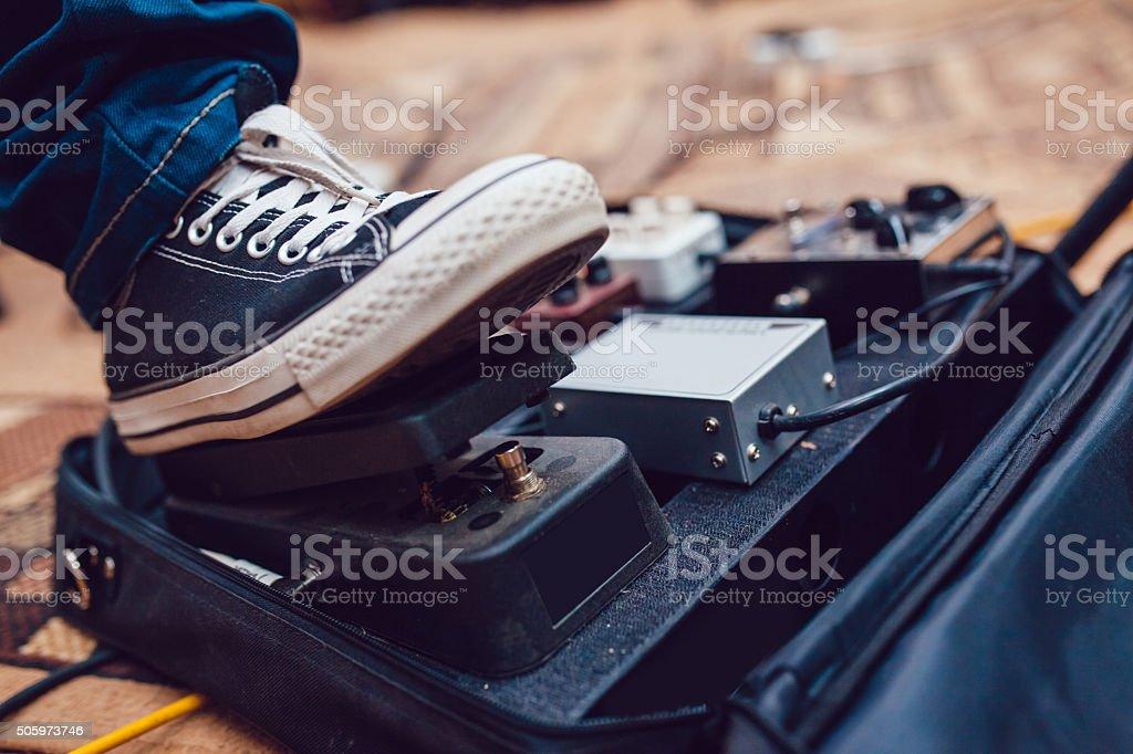 Pedal guitarist stock photo