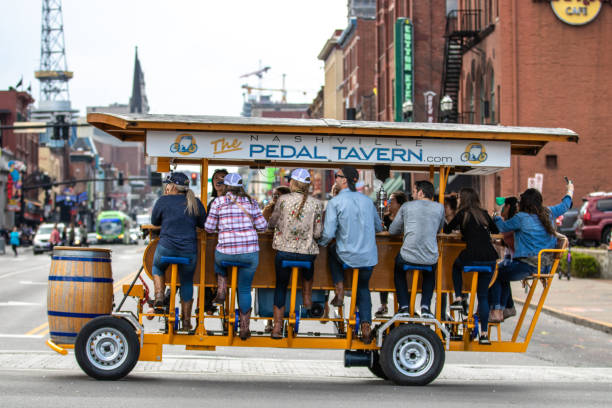 A Pedal Tavern party bike on a beautiful sunny day crossing Broadway.