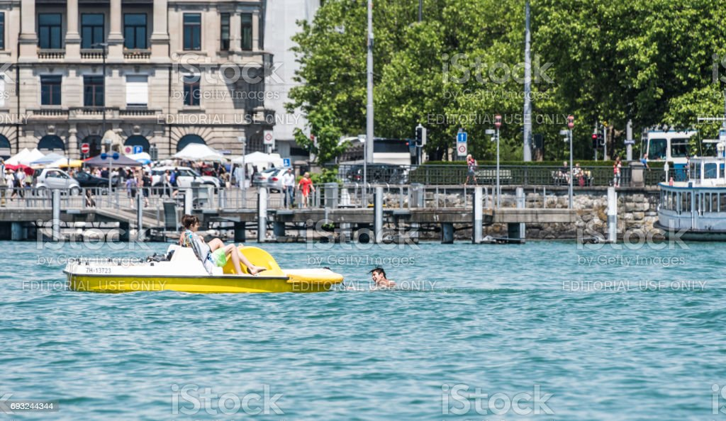 Pedalo and swimmer on Lake Zurich stock photo