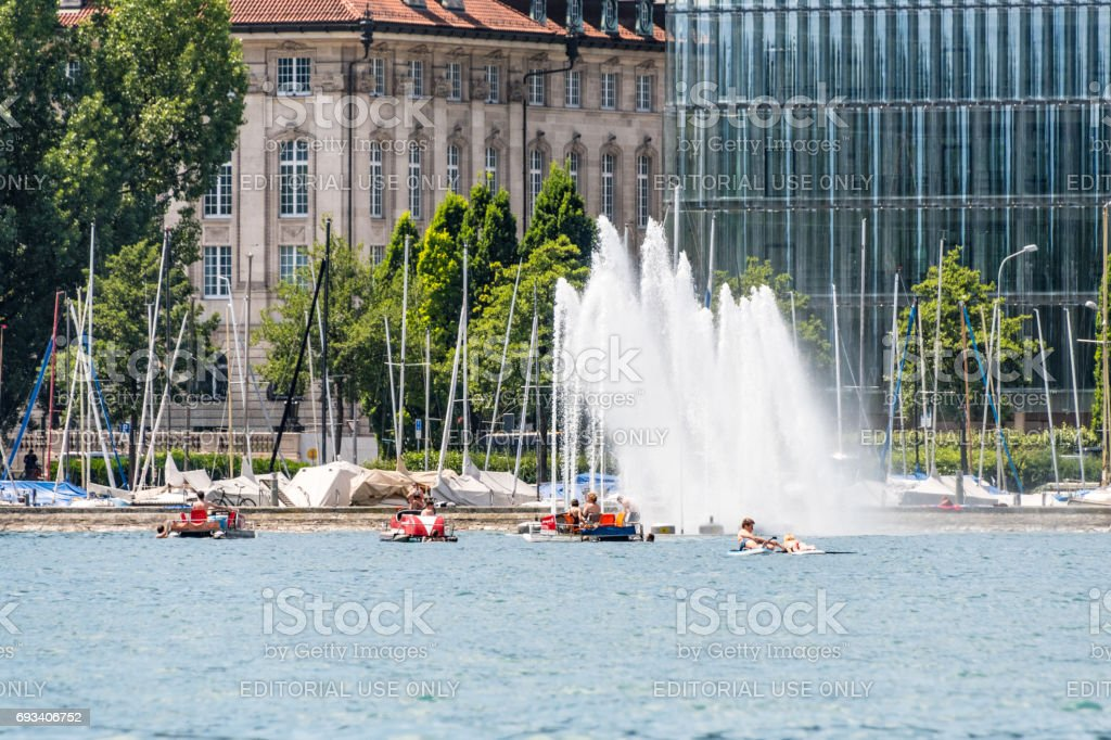 Pedalo boats by fountain on Lake Zurich stock photo