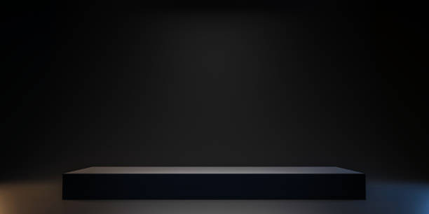 Pedestal of Platform display with black stand podium on dark room background. Blank Exhibition or empty product shelf. 3D rendering. stock photo