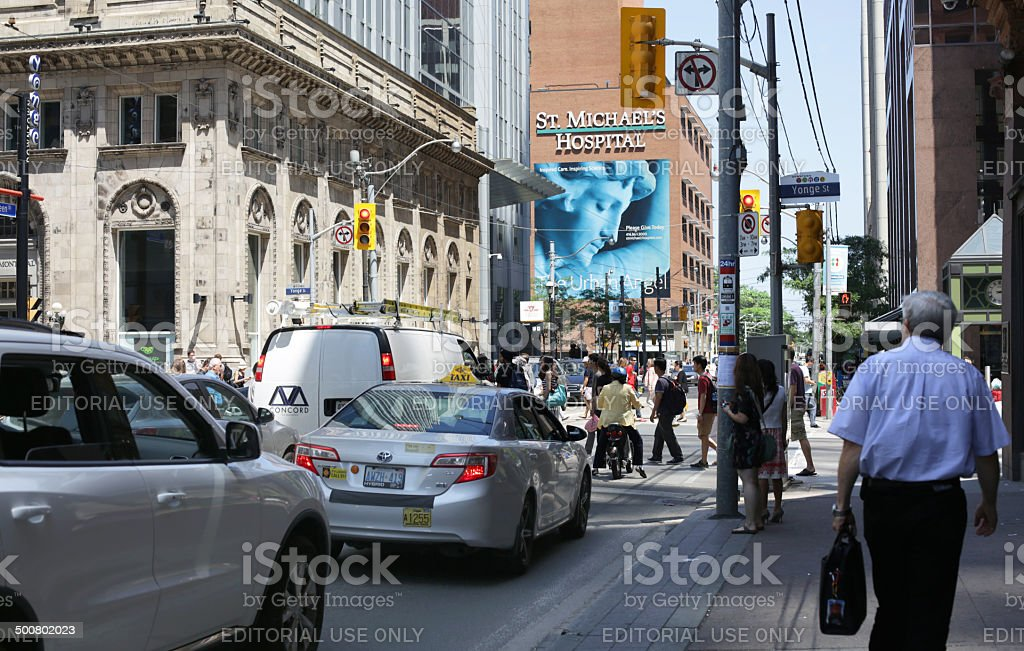 Pedestrans and Traffic, Queen Street at Yonge, Toronto, Canada stock photo