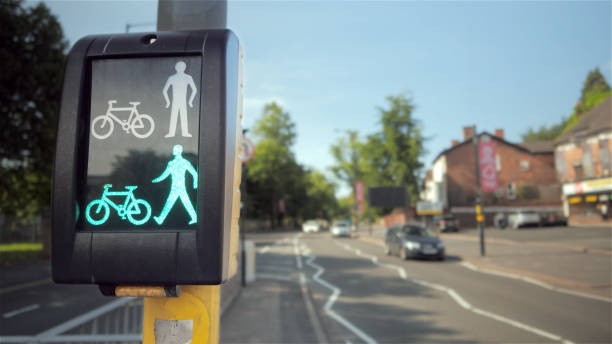 Pedestrian and cyclist road crossing in the UK. stock photo