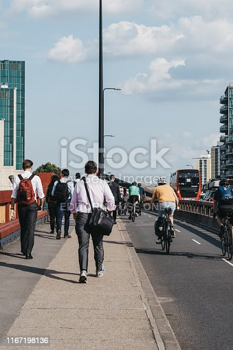 istock Pedestrian and cyclists on Vauxhall Bridge in London, UK, during rush hour, selective focus. 1167198136