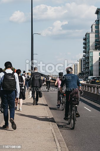 istock Pedestrian and cyclists on Vauxhall Bridge in London, UK, during rush hour, selective focus. 1167198138