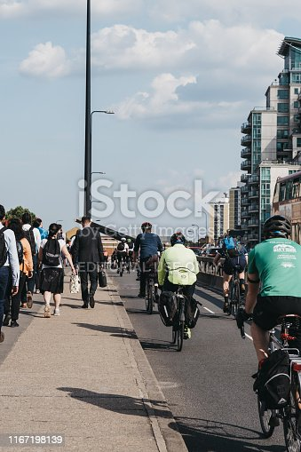 istock Pedestrian and cyclists on Vauxhall Bridge in London, UK, during rush hour, selective focus. 1167198139