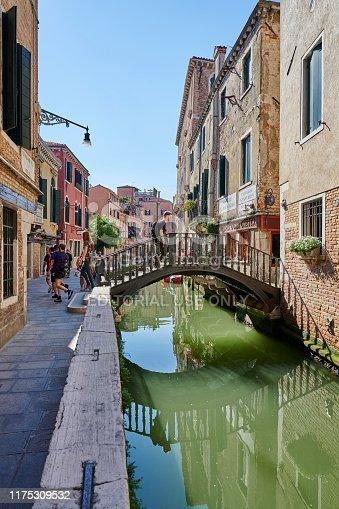 Venice, Italy - June 01, 2019: tourista crossing