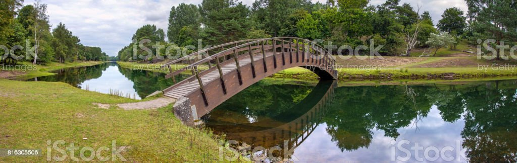 Pedestrian bridge over a canal stock photo