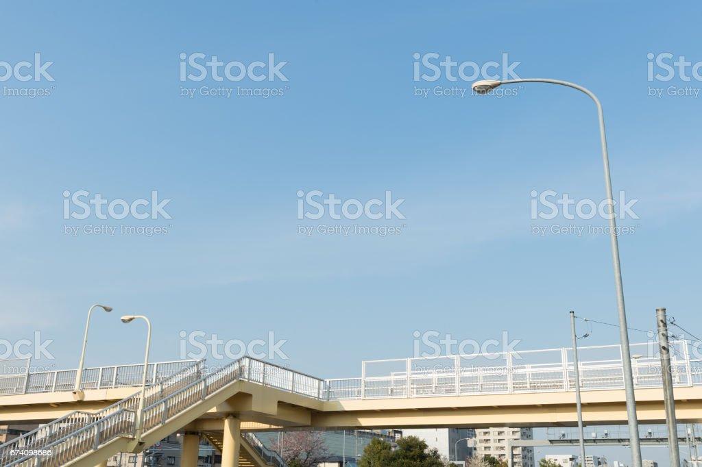 Pedestrian bridge over blue sky royalty-free stock photo
