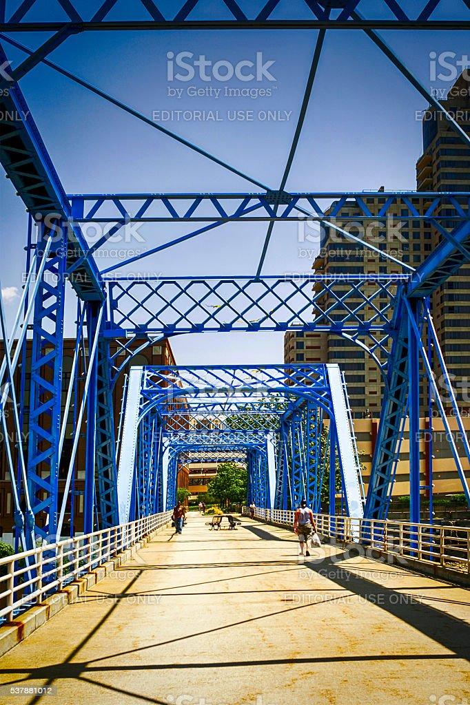 Pedestrian bridge over the Grand River at Grand Rapids Michigan stock photo