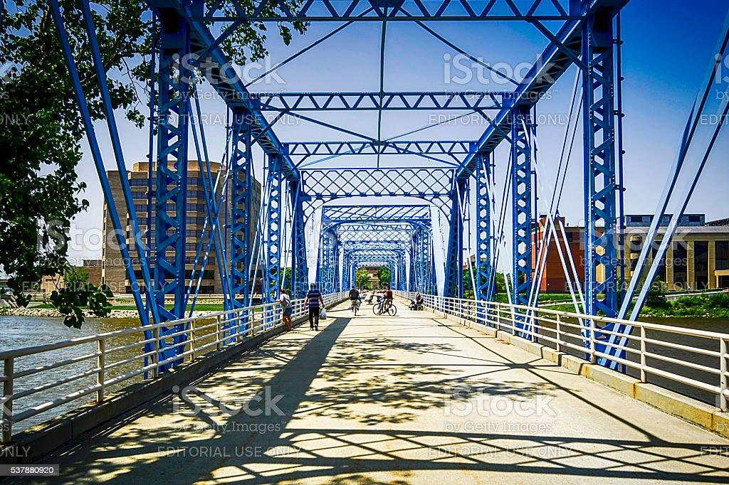Pedestrian bridge over the Grand River in Grand Rapids MI stock photo