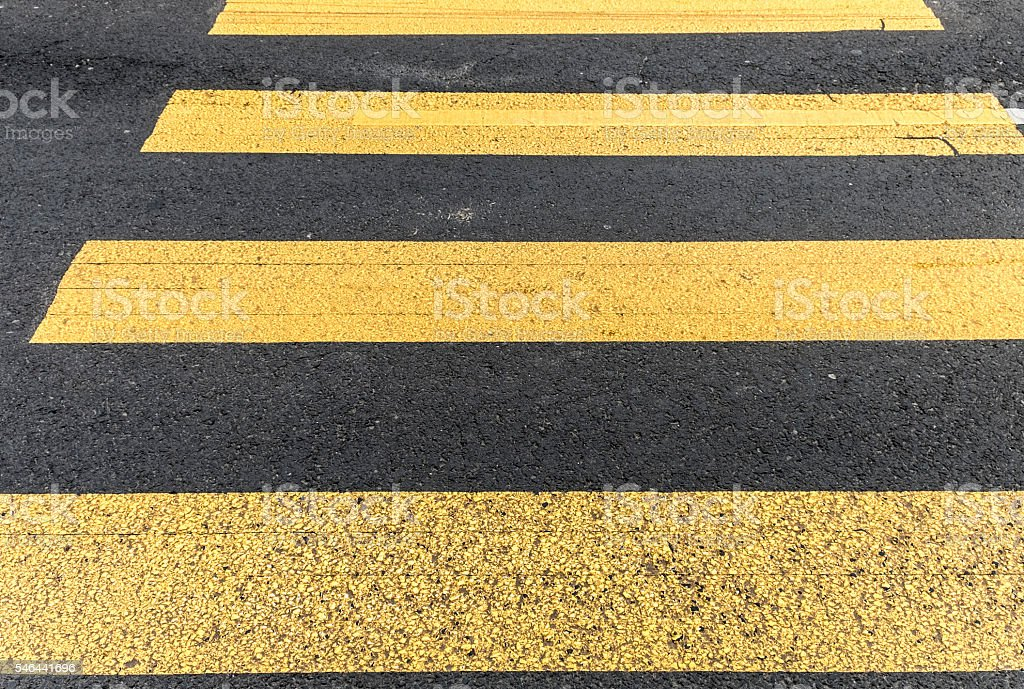 pedestrian crossing in asphalt street and abstract background