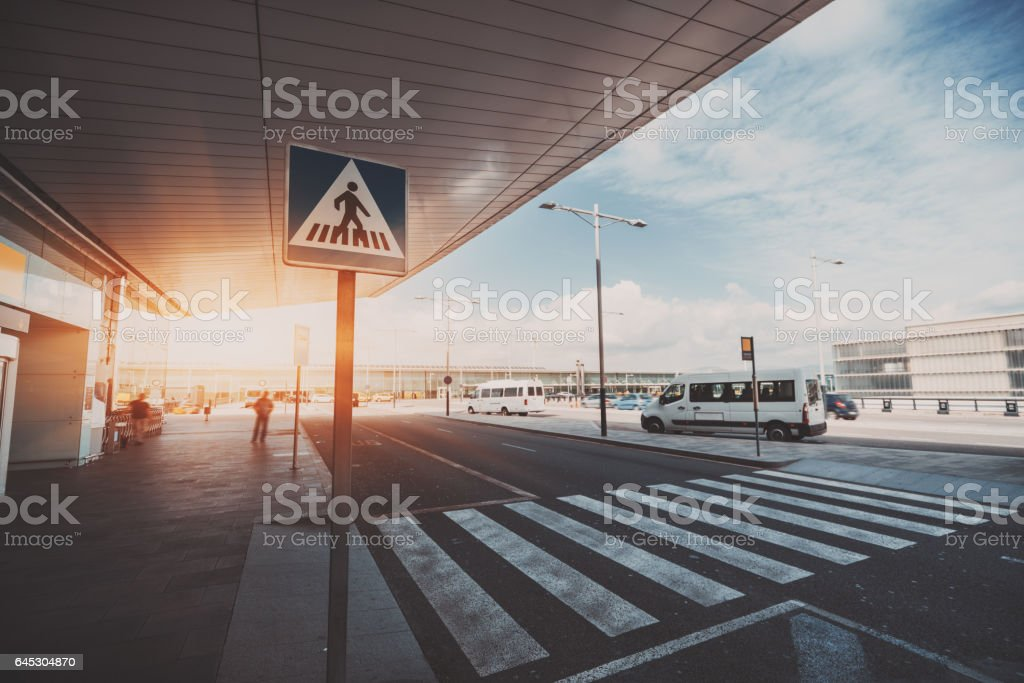 Pedestrian crossing next to airport entrance stock photo