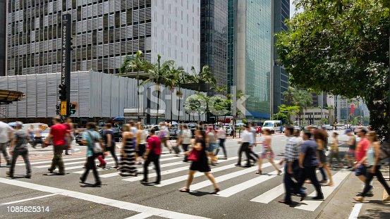 People on crosswalk. Blurred image.