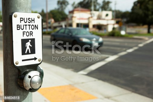Traffic control button for pedestrian crossing.