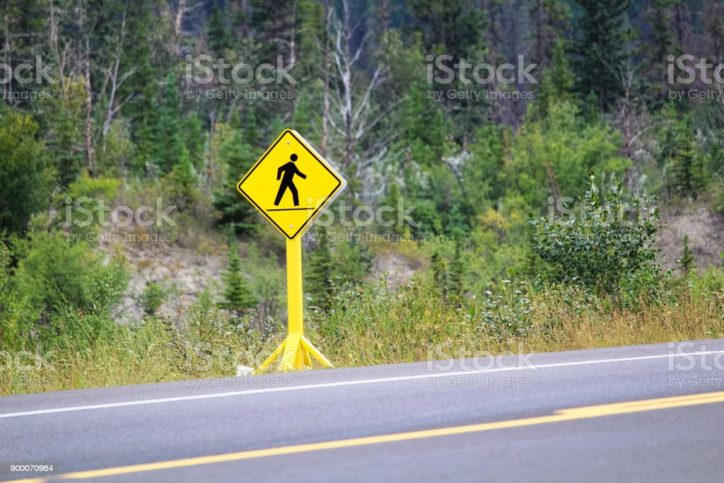 A pedestrian crossing sign on a highway stock photo