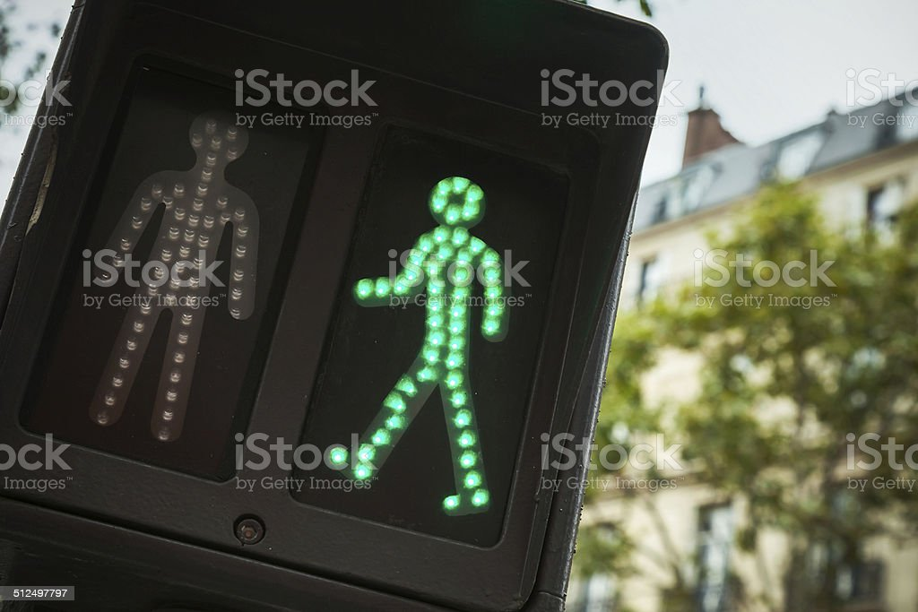 Pedestrian crossing traffic lights show green signal to go stock photo