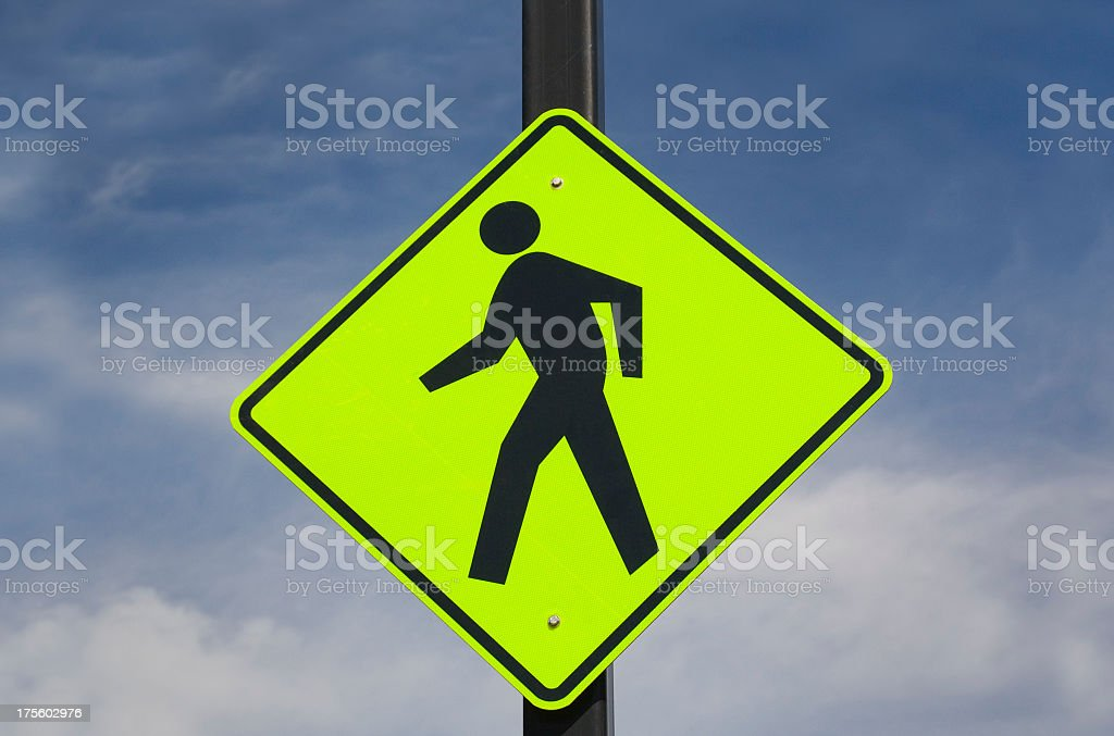 Pedestrian Crossing Warning Sign in Luminescent Green Under Blue Sky royalty-free stock photo