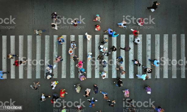 Pedestrian crowd crossing crosswalk top view picture id1143439048?b=1&k=6&m=1143439048&s=612x612&h=2blxlikecfcm dwozlfl0qm1nrbzocawejns9qk5rbe=