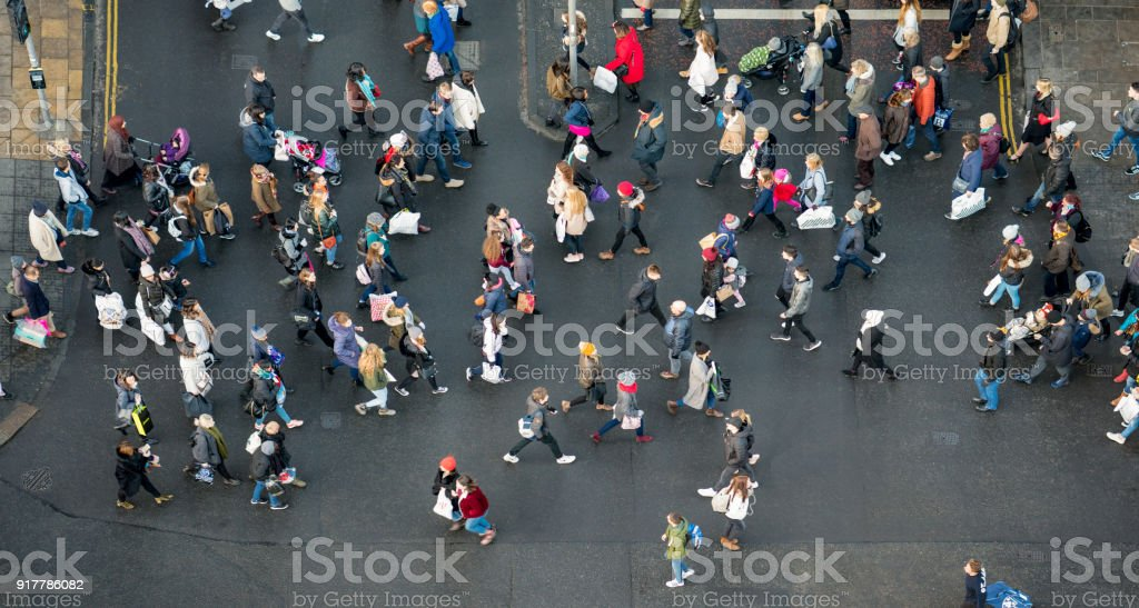 Pedestrian crowds crossing the street - photographed from directly above stock photo