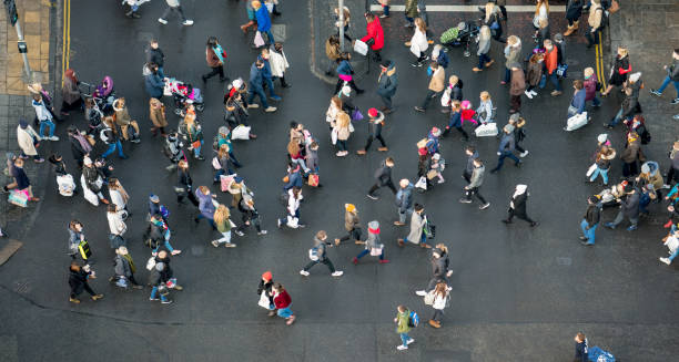 pedestrian crowds crossing the street - photographed from directly above - people uk stock photos and pictures
