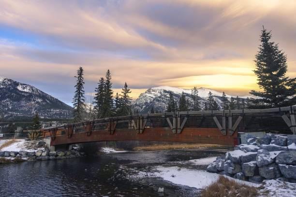 Pedestrian Foot Bridge Spring Creek Mountain Village Canmore Alberta Sunset Sky stock photo